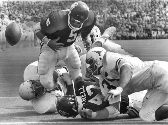 "OU FOOTBALL Steve Davis, University of Oklahoma quarterback, 1973-75;  ""An OU touchdown goes flying out of the arms of Steve Davis.  His fumble at the goal line was recovered by Texas in the end zone.""  The Sooners still managed to beat the Longhorns of Texas, 16-13.   Staff photo by J. Pat Carter taken 10/12/74; photo ran in the 10/13/74 Daily Oklahoman.  File:  Football/OU/OU-Texas/Cotton Bowl/Steve Davis/1974"