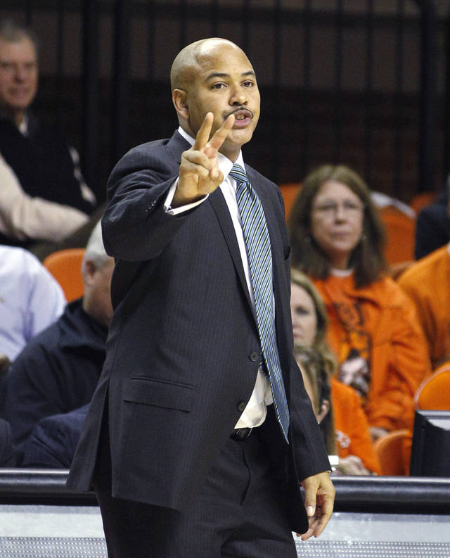 South Florida head coach Stan Heath gestures during the first half of an NCAA college basketball game against Oklahoma State in Stillwater, Okla., Wednesday, Dec. 5, 2012. Oklahoma State won 61-49. (AP Photo/Sue Ogrocki)