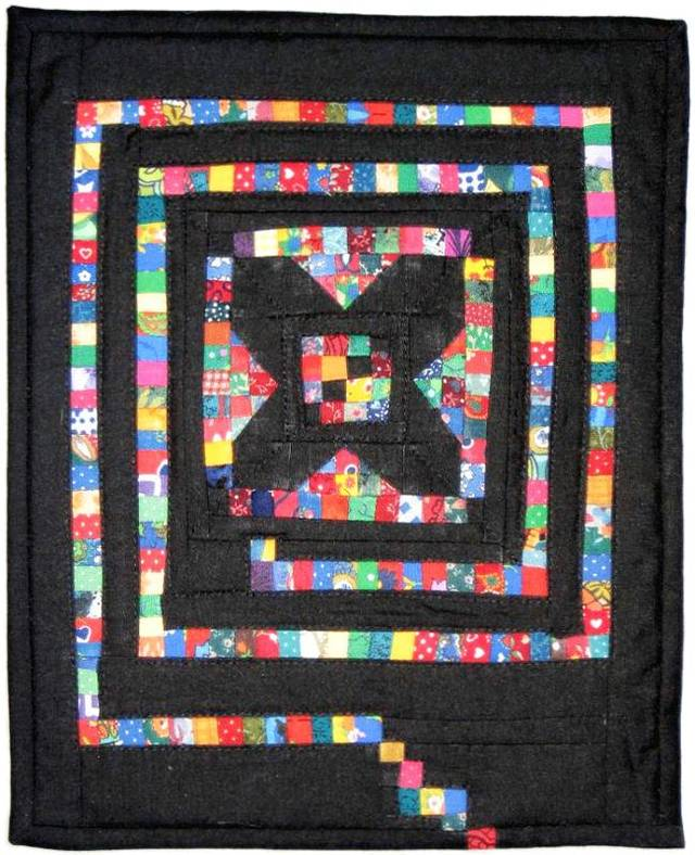 "This mini quilt made by Audrey Arno of Tuttle is titled ""Losing It."" It symbolizes people who are losing their memories to Alzheimer's disease. Arno makes quilts for the Alzheimer's Art Quilt Initiative which auctions them to raise money for Alzheimer's research. Photo provided by Alzheimer's Art Quilt Initiative."