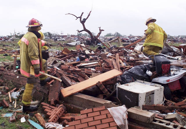 MAY 3, 1999 TORNADO: Tornado damage: Edmond Firefighters search through the remains of a home in Midwest City just East of Sooner-Rose Elementary School for survivors or bodies. ORG XMIT: KOD