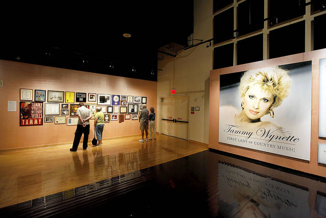 "Guests view memorabilia at the ""Tammy Wynette: First Lady of Country Music"" exhibit Sept. 15 at The Country Music Hall of Fame in Nashville, Tenn.AP photo"