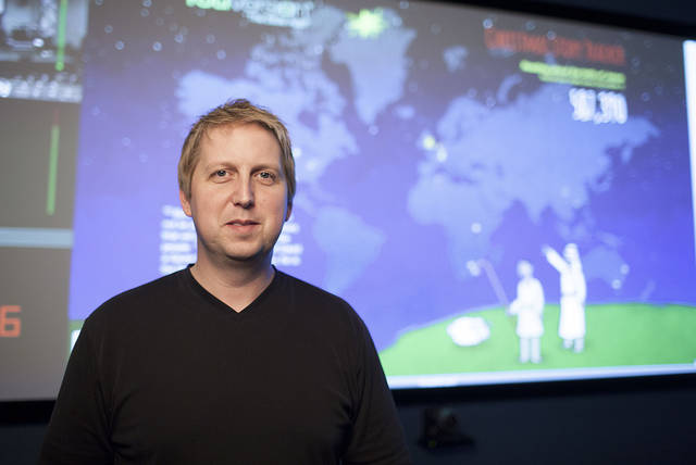 Bobby Gruenewald, pastor-innovation leader at Edmond-based LifeChurch.tv, stands in the church�s Global Operations Center, where leaders have developed a way to track how many people are reading the Christmas story by way of the YouVersion Bible app. Photo provided
