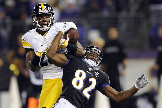 Pittsburgh Steelers defensive back Cortez Allen (28) breaks up a pass intended for Baltimore Ravens wide receiver Torrey Smith (82) during the first half of an NFL football game in Baltimore, Sunday, Dec. 2, 2012. (AP Photo/Nick Wass)