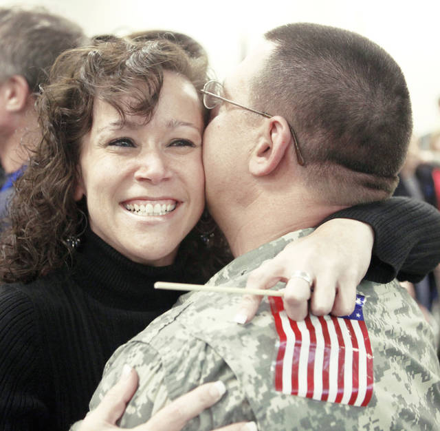 Annette Dannatt welcomes her husband, Lt. Daniel Dannatt, home to Oklahoma after he returns Friday from training Afghan police officers.  Photo by Steve Gooch, The Oklahoman