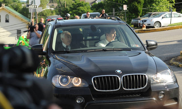Former Penn State University assistant football coach Jerry Sandusky and his attorney Joe Amendola arrive for the fourth day of Sandusky's trial at the Centre County Courthouse in Bellefonte, Pa., Thursday, June 14, 2012. Sandusky faces 52 counts of child sex-abuse involving 10 boys over a 15-year span. (AP Photo/Centre Daily Times, Nabil K. Mark)