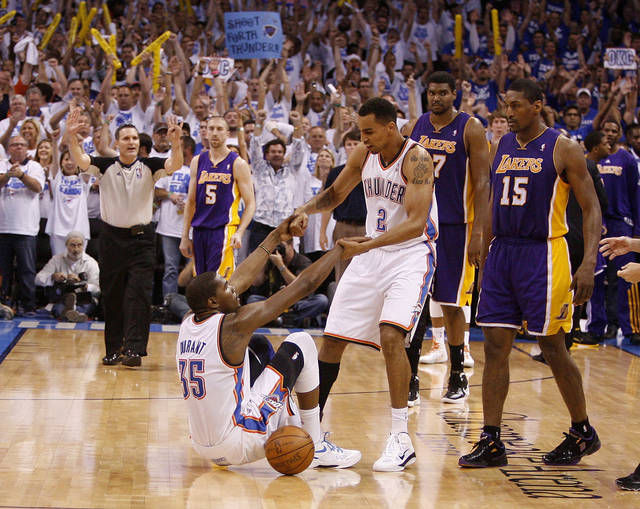 Oklahoma City's Thabo Sefolosha (2) helps Kevin Durant (35) up after a foul as Los Angeles' Metta World Peace (15) and Andrew Bynum (17) watch in the final second of Game 2 in the second round of the NBA playoffs between the Oklahoma City Thunder and L.A. Lakers at Chesapeake Energy Arena in Oklahoma City, Wednesday, May 16, 2012.  Oklahoma City won 77-75.  Photo by Bryan Terry, The Oklahoman