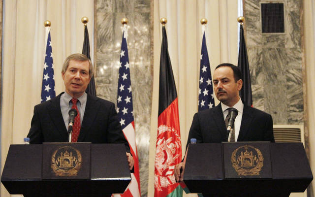 James Warlick, left, the U.S. deputy special representative for Afghanistan and Pakistan speaks, as Eklil Hakimi, Afghanistan's ambassador in Washington listens during a joint press conference in Kabul, Afghanistan, Thursday, Nov. 15, 2012. The United States and Afghanistan are starting negotiations on an agreement that will shape America's military presence in the country after the withdrawal of most foreign combat troops at the end of 2014. (AP Photo/Ahmad Jamshid)