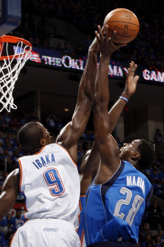 Oklahoma City's Serge Ibaka (9) blocks the shot of Dallas' Ian Mahinmi (28) during game one of the first round in the NBA playoffs between the Oklahoma City Thunder and the Dallas Mavericks at Chesapeake Energy Arena in Oklahoma City, Saturday, April 28, 2012. Photo by Nate Billings, The Oklahoman