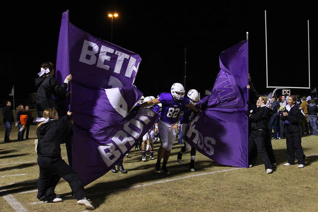Bethany Broncos players crash through the banner before the Class 3A quarterfinals between Bethany and Cascia Hall in Bethany, Friday, November 25, 2011. PHOTO BY HUGH SCOTT, FOR THE OKLAHOMAN