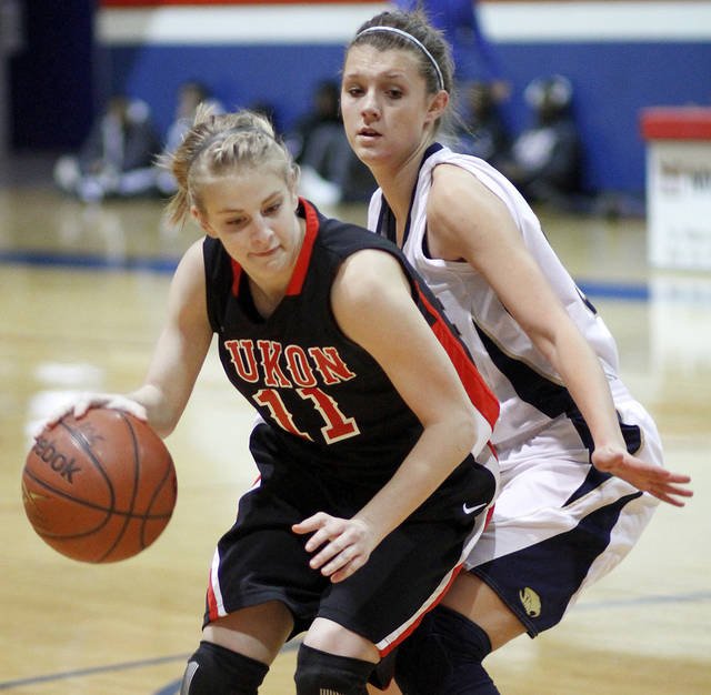 Far left:  Yukon High School's  Kaitlyn  Norton drives past Southmoore High School's  Bailey Olsen during a high school basketball game.  PHOTO BY  BRYAN TERRY,  the OKLAHOMAN ARCHIVEs