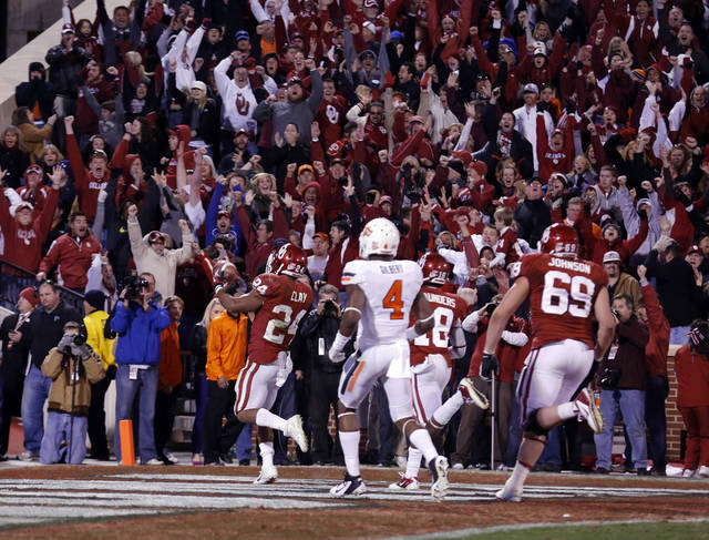 Oklahoma junior Brennan Clay scores the game-winning touchdown in overtime of the Sooners' 51-48 victory over Oklahoma State on Nov. 24. PHOTO BY SARAH PHIPPS, THE OKLAHOMAN