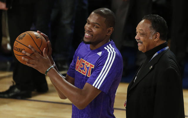 West Team's Kevin Durant, of the Oklahoma City Thunder, left, speaks with the Rev. Jesse Jackson Sr. before the NBA All Star basketball game, Sunday, Feb. 16, 2014, in New Orleans. (AP Photo/Bill Haber)