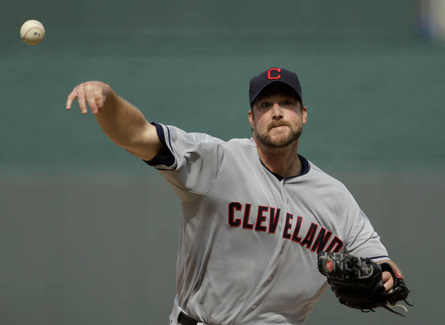 Cleveland Indians starting pitcher Derek Lowe throws during the first inning of a baseball game against the Kansas City Royals, Friday, April 13, 2012, in Kansas City, Mo. (AP Photo/Charlie Riedel)