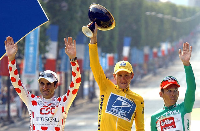 FILE - This July 28, 2002 file photo shows Lance Armstrong, center, waving from the podium as he holds the winner's trophy, along with best sprinter Robbie McEwen, of Australia, right, and best climber Laurent Jalabert, of France, after the 20th and final stage of the Tour de France cycling race between Melun and Paris. Armstrong was stripped of his seven Tour de France titles and banned for life by cycling's governing body Monday, Oct. 22, 2012, following a report from the U.S. Anti-Doping Agency that accused him of leading a massive doping program on his teams. UCI President Pat McQuaid announced that the federation accepted the USADA's report on Armstrong and would not appeal to the Court of Arbitration for Sport.  (AP Photo/Peter Dejong) ORG XMIT: NY153