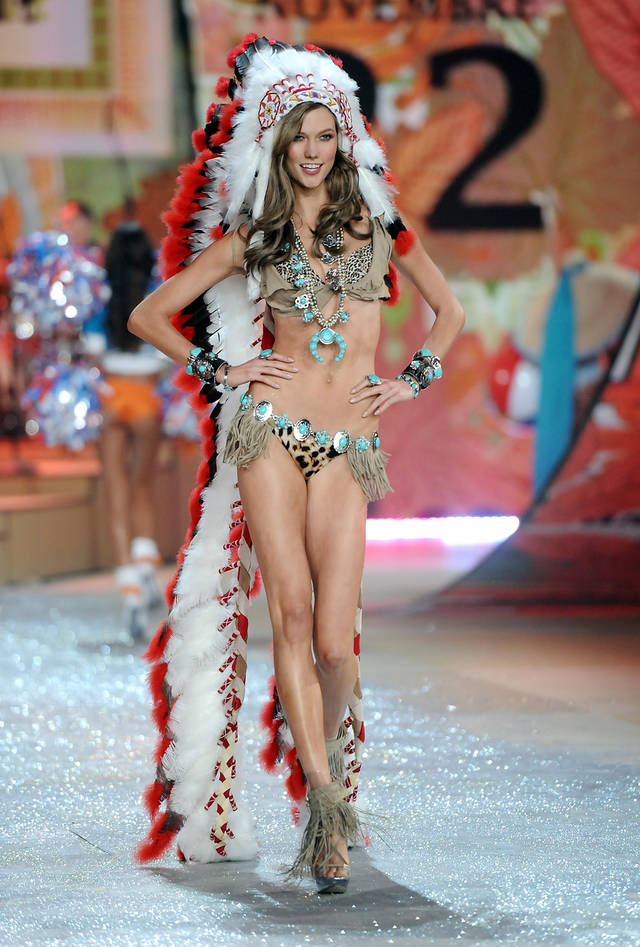 FILE - This Nov. 7, 2012 file photo shows model Karlie Kloss wearing an Indian headdress during the 2012 Victoria's Secret Fashion Show in New York. Victoria Secret has apologized for putting a replica of a Native American headdress on a model for its annual fashion show. The company responded to criticism over the weekend by saying it was sorry to have upset anyone and would not include the outfit in the show�s television broadcast next month. (Photo by Evan Agostini/Invision/AP, file)
