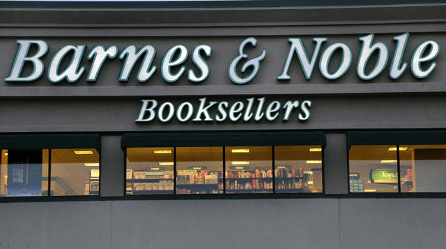 In this Tuesday, Nov. 27, 2012, photo, The exterior of a Barnes & Noble bookstore is seen in Salem, N.H. Barnes & Noble on Thursday, Nov. 29, 2012, said it turned a profit in its fiscal second-quarter as higher revenue from its Nook e-book and e-bookstore division offset a decline at retail stores. The largest traditional book retailer has been fighting tough competition from online retailers and discount stores by investing heavily in its Nook e-book reader. (AP Photo/Elise Amendola)