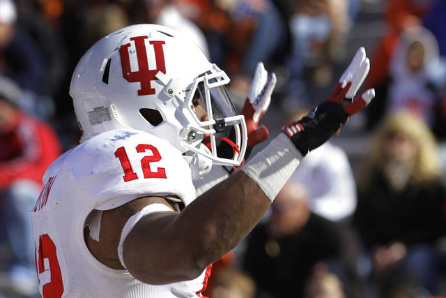 Indiana running back Stephen Houston (12) celebrates after scoring a touchdown during the first half of an NCAA college football game against Illinois, Saturday, Oct. 27, 2012 in Champaign, Ill. (AP Photo/Seth Perlman)