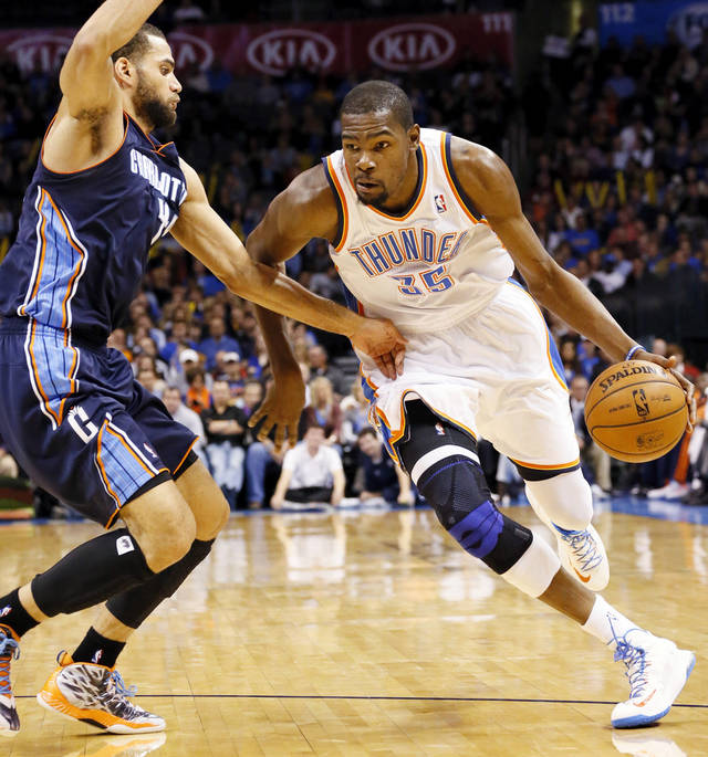 Oklahoma City's Kevin Durant (35) drives the ball against Charlotte's Jeffery Taylor (44) during an NBA basketball game between the Oklahoma City Thunder and Charlotte Bobcats at Chesapeake Energy Arena in Oklahoma City, Monday, Nov. 26, 2012.  Photo by Nate Billings , The Oklahoman