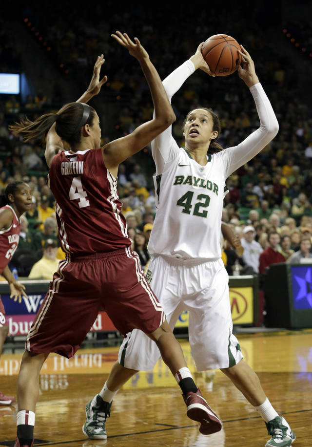 CORRECTS YEAR - Baylor's Brittney Griner (42) shoots against Oklahoma's Nicole Griffin (4) during the first half of an NCAA college basketball game Saturday, Jan. 26, 2013, in Waco Texas. (AP Photo/LM Otero) ORG XMIT: TXMO101