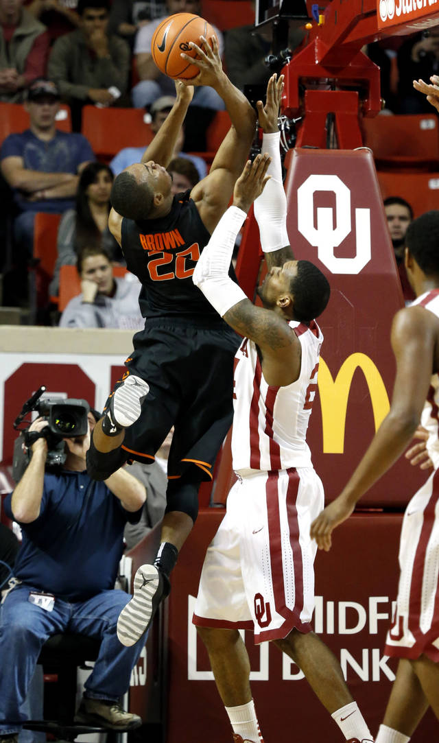Cowboy's Markel Brown (22) shoots guarded by Sooner's Steven Pledger (2) during the second half as the University of Oklahoma Sooners (OU) defeat  the Oklahoma State Cowboys (OSU) 77-68  in NCAA, men's college basketball at The Lloyd Noble Center on Saturday, Jan. 12, 2013  in Norman, Okla. Photo by Steve Sisney, The Oklahoman