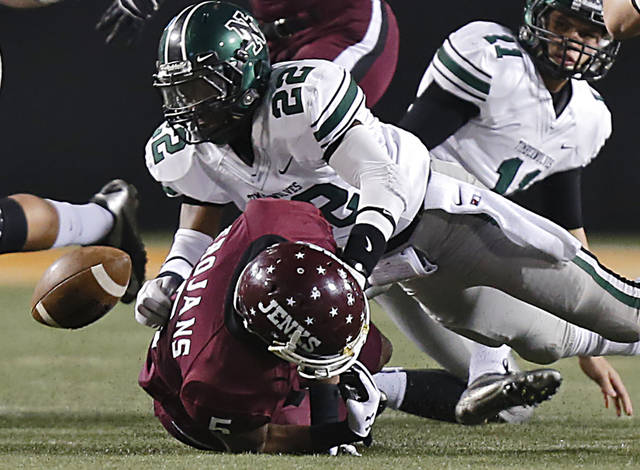 Norman North's Adim Chukwurah (22) forces a fumble on Jenks' Trey'Vonne Barr'e (5) during the Class 6A Oklahoma state championship football game between Norman North High School and Jenks High School at Boone Pickens Stadium on Friday, Nov. 30, 2012, in Stillwater, Okla.   Photo by Chris Landsberger, The Oklahoman