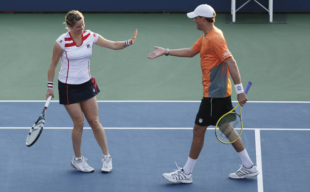 Belgium's Kim Clijsters, left, and Bob Bryan celebrate during their mixed doubles match against Irina Falconi and Steve Johnson in the third round of play at the 2012 US Open tennis tournament, Friday, Aug. 31, 2012, in New York. (AP Photo/Charles Krupa)