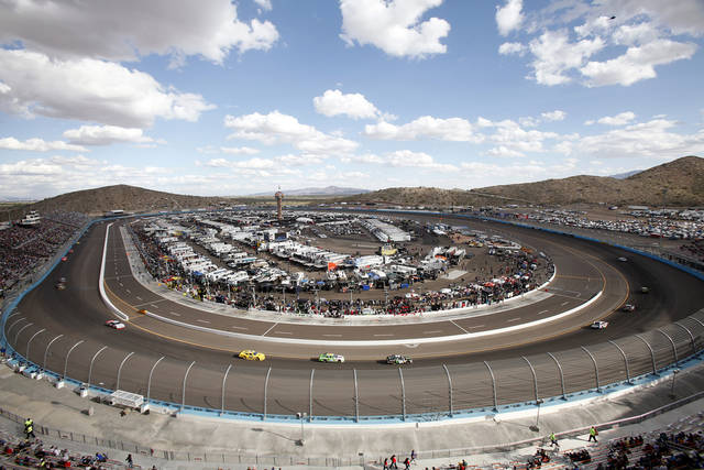 Drivers round the first and second turns during the NASCAR Nationwide Series auto race Saturday, Nov. 10, 2012, at Phoenix International Raceway in Avondale, Ariz.(AP Photo/Paul Connors)