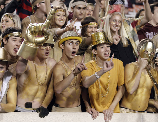 Jenks' fans have fun in the stands during the Class 6A Oklahoma state championship football game between Norman North High School and Jenks High School at Boone Pickens Stadium on Friday, Nov. 30, 2012, in Stillwater, Okla.   Photo by Chris Landsberger, The Oklahoman