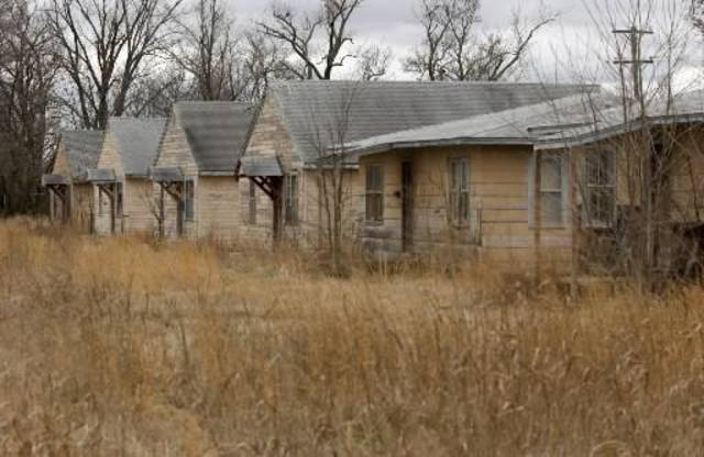 Row of abandoned homes in Picher. GARY CROW/FOR THE TULSA WORLD
