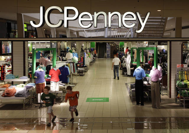 FILE - In this Tuesday, June 19, 2012 file photo, shoppers walk in a J.C. Penney story in Plano, Texas. J.C. Penney Co. reported a bigger-than-expected loss in the third quarter on plummeting sales as customers continue to reject its move get rid of blockbuster sales in favor of everyday low pricing, according to reports Friday, Nov. 9, 2012. (AP Photo/LM Otero)
