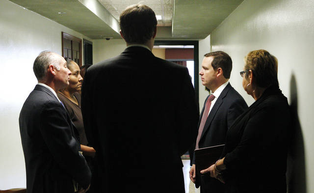 Assistant Oklahoma County District Attorney Matt Dillon, second from right, speaks Wednesday with family members of stabbing victim Manuel Leon Sanchez and attorney David Slane after the Billy Thompson hearing at the Oklahoma County Courthouse in Oklahoma City.  Photo by Paul B. Southerland, The Oklahoman <strong>PAUL B. SOUTHERLAND</strong>