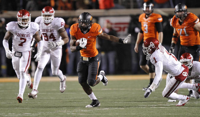 Oklahoma State's Joseph Randle (1) runs past the Oklahoma defense during the Bedlam college football game between the Oklahoma State University Cowboys (OSU) and the University of Oklahoma Sooners (OU) at Boone Pickens Stadium in Stillwater, Okla., Saturday, Dec. 3, 2011. Photo by Chris Landsberger, The Oklahoman