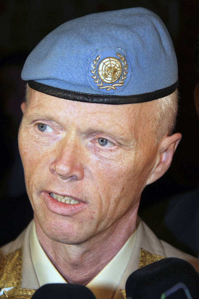 Norwegian Maj. Gen. Robert Mood, head of the U.N. observer team in Syria, right, speaks to reporters after his arrival in Damascus, Sunday, April 29, 2012. Under the peace plan, the U.N. is to deploy as many as 300 truce monitors. One hundred should be in the country by mid-May, and the head of the observer team, Norwegian Maj. Gen. Robert Mood, arrived in Damascus on Sunday to assume command, according to the mission's spokesman, Neeraj Singh.(AP Photo/Bassem Tellawi)