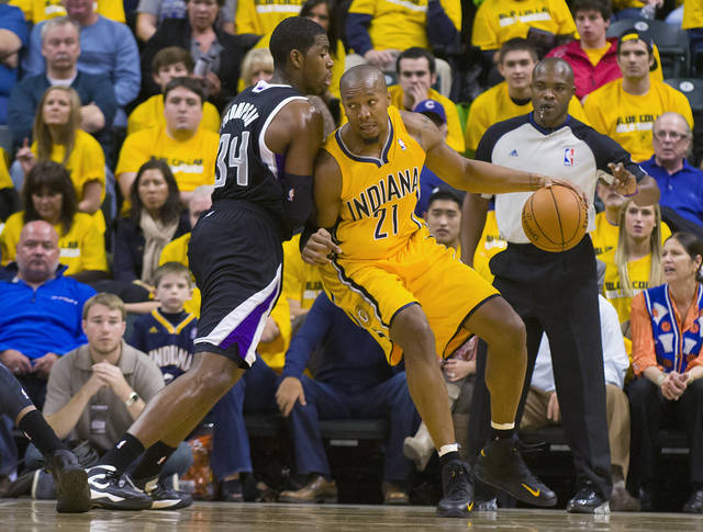 Indiana Pacers' David West works the ball inside against Sacramento Kings' Jason Thompson during the first quarter of an NBA basketball game in Indianapolis on Saturday, Nov. 3, 2012. (AP Photo/Doug McSchooler)