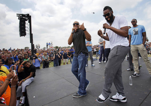 James Harden, front right, laughs as Derek Fisher, left, speaks during a welcome home rally for the Oklahoma City Thunder in a field at Will Rogers World Airport after the team's loss to the Miami Heat in the NBA Finals, Friday, June 22, 2012. At right in the background is Serge Ibaka. Photo by Nate Billings, The Oklahoman