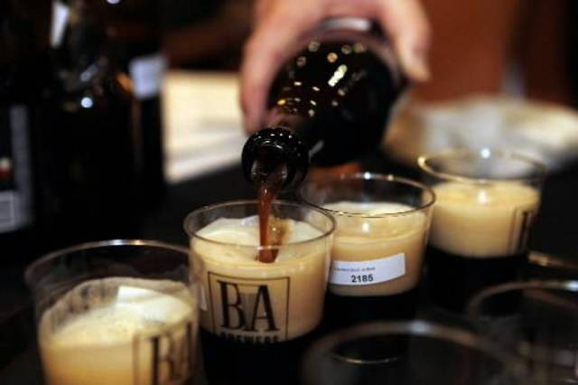 Beer is poured into cups in this AP photo. Oklahoma health and human services agency heads said Wednesday that Oklahoma legislators should consider increasing the tax on alcohol and beer to help pay for treatment costs and not send as many nonviolent offenders to prison.