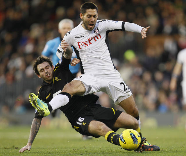 FILE - This is a Saturday, Dec. 17, 2011 file photo shows Fulham's Clint Dempsey, right, as he challenges Bolton Wanderers' Mark Davies for the ball during their English Premier League soccer match at Fulham's Craven Cottage stadium in London. United States international Clint Dempsey has refused to play for Fulham again and is seeking a transfer to a Champions League club, the Premier League club's coach Martin Jol announced on Friday Aug. 17, 2012. (AP Photo/Alastair Grant, File)