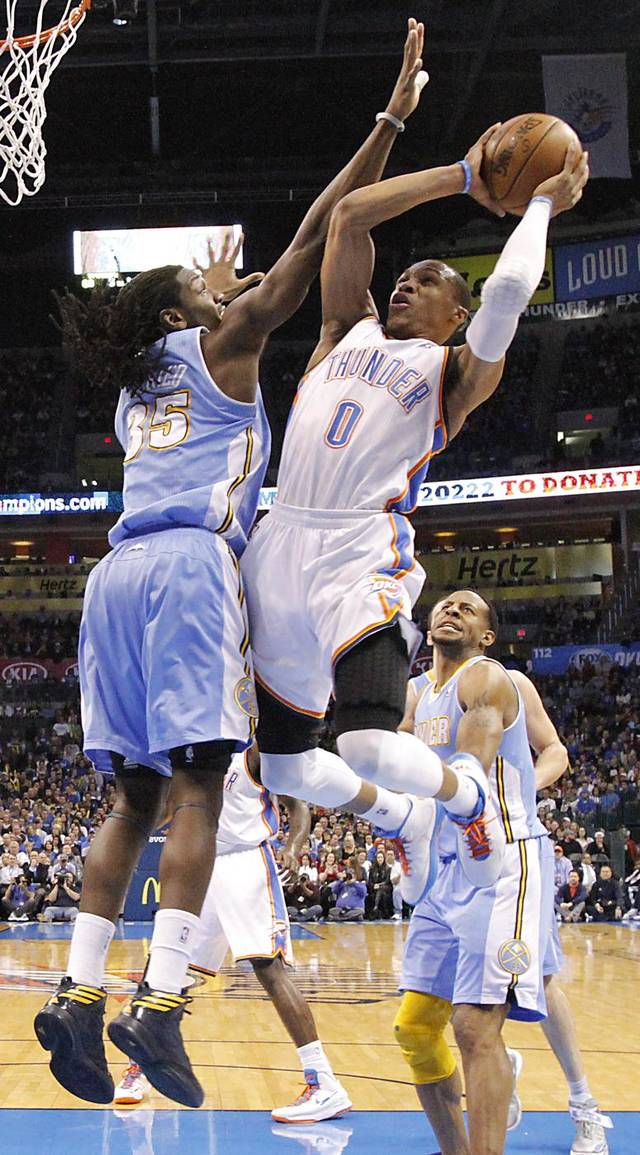 Oklahoma City's Russell Westbrook (0) drives to the basket past Denver's Kenneth Faried (35) during the NBA basketball game between the Oklahoma City Thunder and the Denver Nuggets at the Chesapeake Energy Arena on Wednesday, Jan. 16, 2013, in Oklahoma City, Okla.  Photo by Chris Landsberger, The Oklahoman