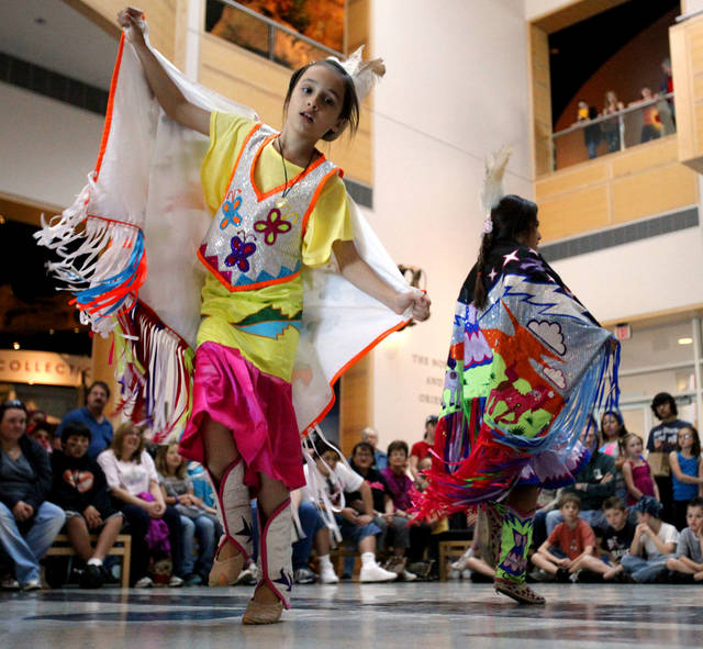 Peyton Pahsetopah, 9, dances as The Dancing Eagles native dancers show colorful costume and dance at the Sam Noble Oklahoma Museum of Natural History during Spring Break Escape on Friday, March 23, 2012, in Norman, Okla.  Photo by Steve Sisney, The Oklahoman