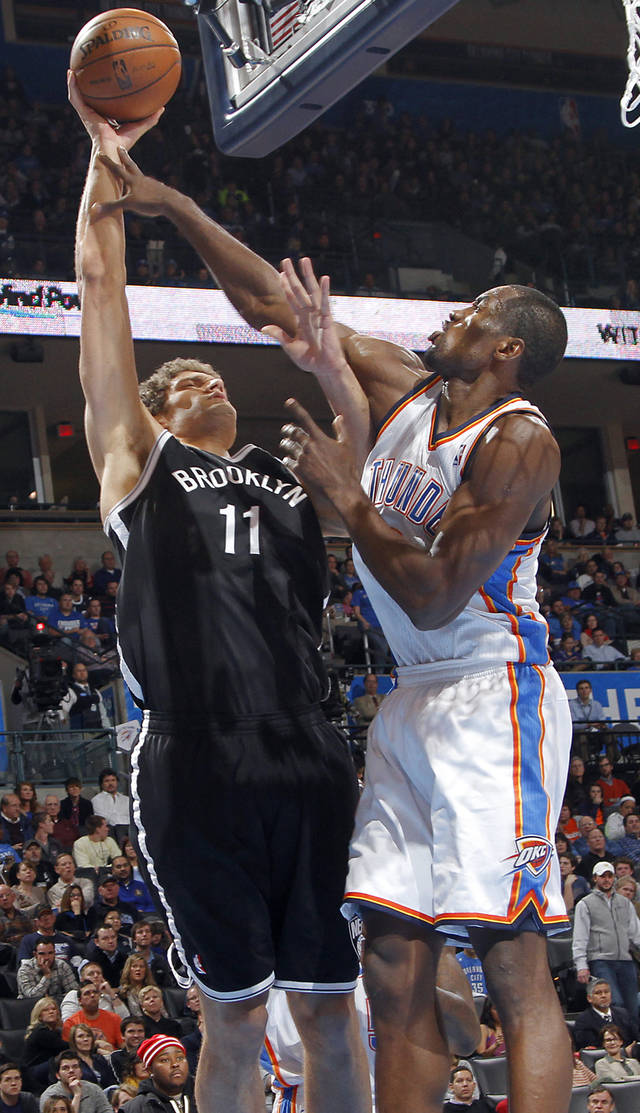Oklahoma City's Serge Ibaka (9) tries to defend on Brooklyn Nets' Brook Lopez (11) during the NBA basketball game between the Oklahoma City Thunder and the Brooklyn Nets at the Chesapeake Energy Arena on Wednesday, Jan. 2, 2013, in Oklahoma City, Okla. Photo by Chris Landsberger, The Oklahoman