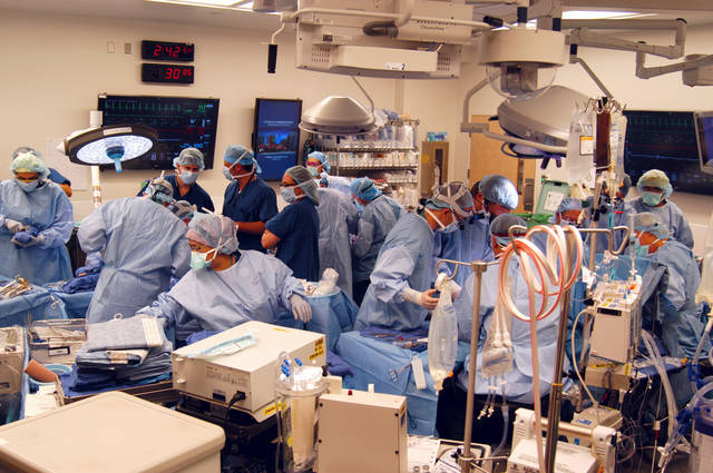 In a Dec. 18, 2012 photo provided by Johns Hopkins Medical, a surgical team at Johns Hopkins Hospital in Baltimore works on a double arm transplant for U.S. Army infantryman Brendan Marroco, 26, who lost all four limbs in Iraq. The transplants are only the seventh double-hand or double-arm transplant ever conducted in the United States. The infantryman was injured by a roadside bomb in 2009. (AP Photo/Johns Hopkins Medical)