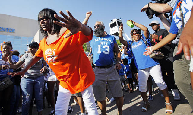 Mary Williams, left, dances with other fans in Thunder Alley before Game 1 of the NBA Finals between the Oklahoma City Thunder and the Miami Heat at Chesapeake Energy Arena in Oklahoma City, Tuesday, June 12, 2012. Photo by Nate Billings, The Oklahoman