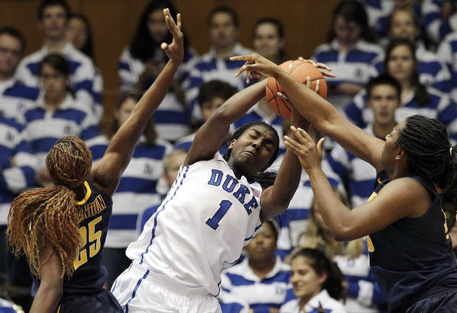 Duke's Elizabeth Williams (1) struggles for a rebound against California's Gennifer Brandon (25) and Talia Caldwell during the second half of an NCAA college basketball game in Durham, N.C., Sunday, Dec. 2, 2012. Duke won 77-63. (AP Photo/Gerry Broome)
