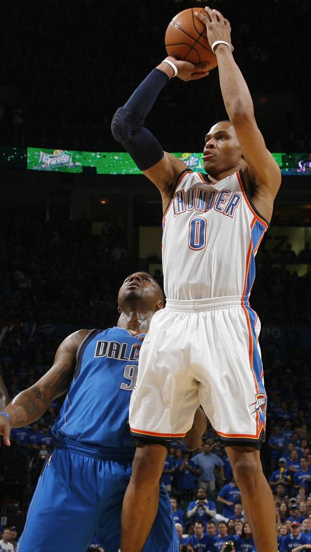 Oklahoma City&#039;s Russell Westbrook (0) takes a shot in front of DeShawn Stevenson (92) in the first half during game 4 of the Western Conference Finals in the NBA basketball playoffs between the Dallas Mavericks and the Oklahoma City Thunder at the Oklahoma City Arena in downtown Oklahoma City, Monday, May 23, 2011. Photo by Nate Billings, The Oklahoman