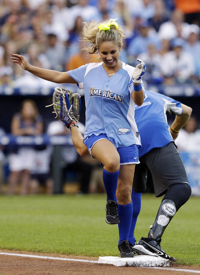 Singer Haley Reinhart is forced out at first base during the first inning of the MLB All-Star celebrity softball game, Sunday, July 8, 2012, in Kansas City, Mo. (AP Photo/Charlie Riedel)