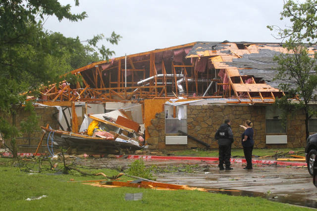The Green Oaks Nursing and Rehabilitation center is damaged after tornadoes swept through the area, Tuesday, April 3, 2012, in Arlington, Texas. (AP Photo/The Fort Worth Star-Telegram, Rodger Mallison) MAGS OUT