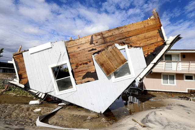 Part of a home rests upside-down in Seaside Heights, N.J. on Wednesday, Oct. 31, 2012 after superstorm Sandy made landfall in New Jersey on Monday evening. The rest of the home sat away from its original spot an in the middle of a street. (AP Photo/Julio Cortez) ORG XMIT: NJJC108