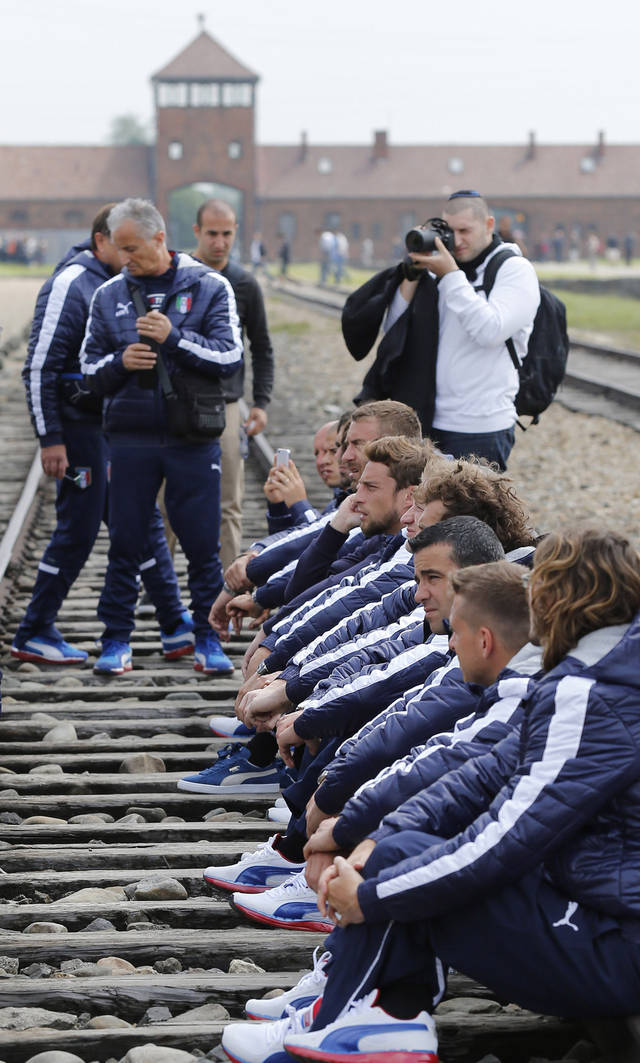 Italy' s national soccer team players visit the Nazi's death camp Auschwitz-Birkenau in Oswiecim, Poland, Wednesday, June 6, 2012. The Italian team is in Poland for the Euro 2012 soccer championship. Their first match is against Spain on June 10. The team also plays Croatia and Ireland in Group C. (AP Photo/Gregorio Borgia)