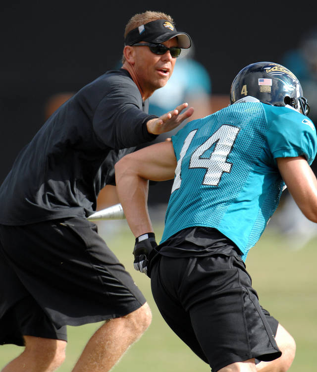 Todd Monken, left, works with rookie receiver Andy Strickland when Monken was with the NFL's Jacksonville Jaguars. Photo by the Florida Times-Union
