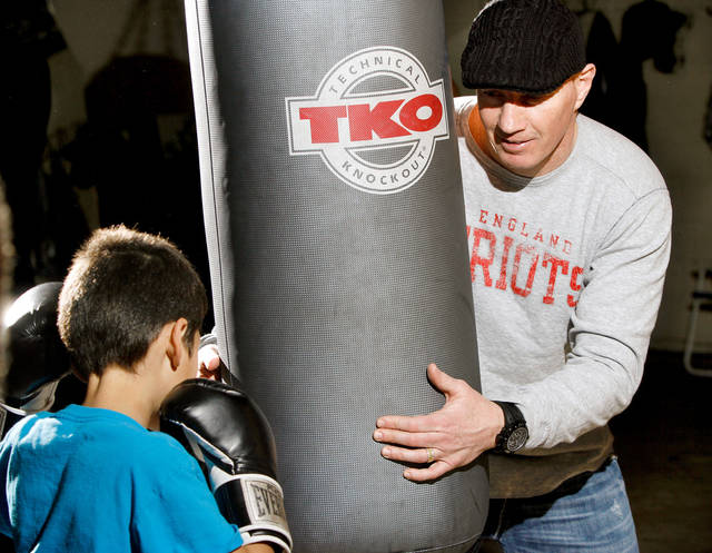"Former junior welterweight champion Micky Ward visited with young boxers, including Eric Moses Puente, 9,  during a promotional appearance at Azteca Gym in south Oklahoma City. Ward's career sparked the Oscar-winning movie ""The Fighter"".   He was at the gym Wednesday afternoon,  Jan. 25, 2012.   Photo by Jim Beckel, The Oklahoman"